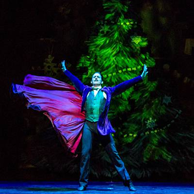 Miguel Blanco as the Great Impresario in front of the growing tree (Photo by Cheryl Mann)