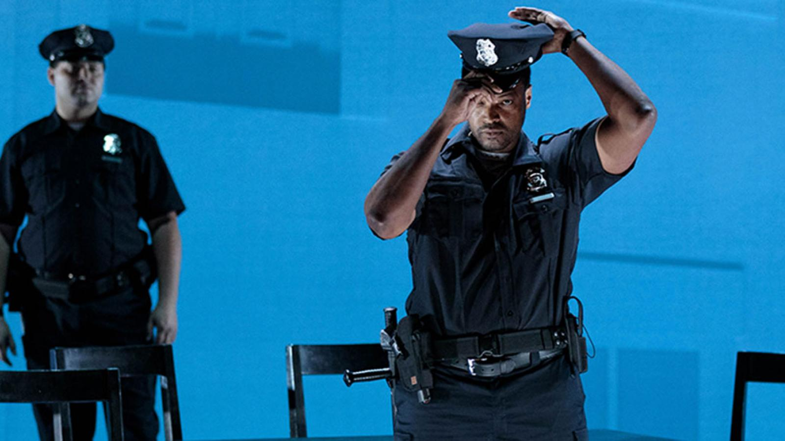 Lyric Opera's Blue image with two men dressed as police on stage