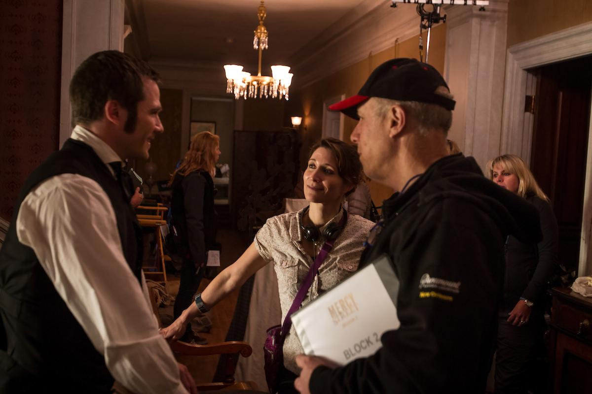 Wolfinger on set speaking to Luke MacFarlane, who plays Chaplain Hopkins. (Courtesy of PBS/Erik Heinila)