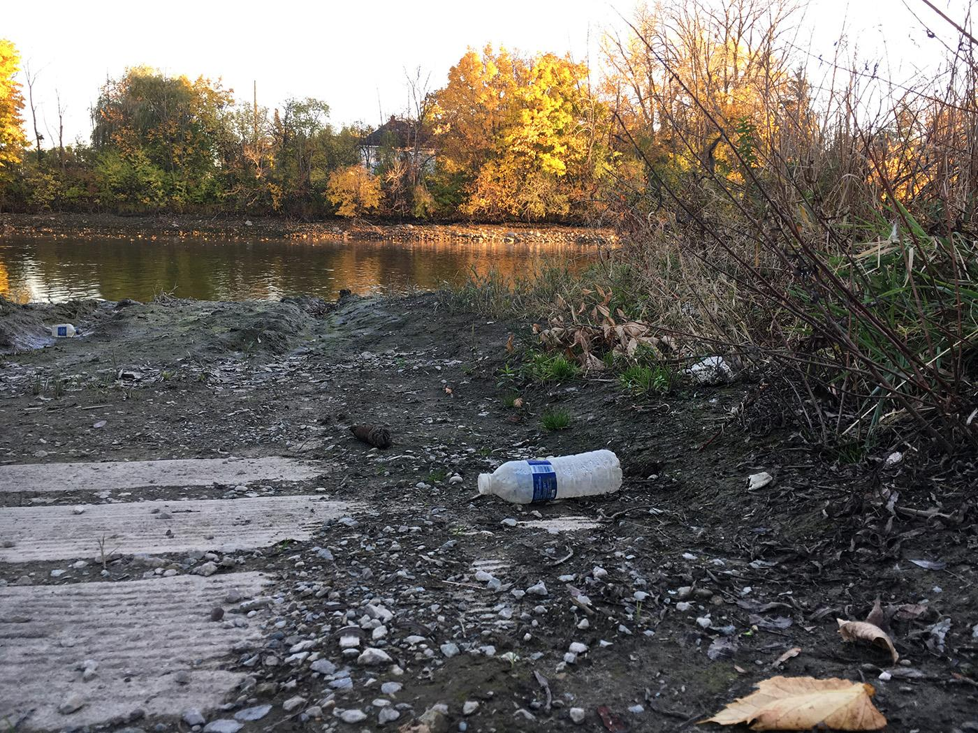 Water bottles littering the Flint River. Photo: Caitlin Saks/WGBH