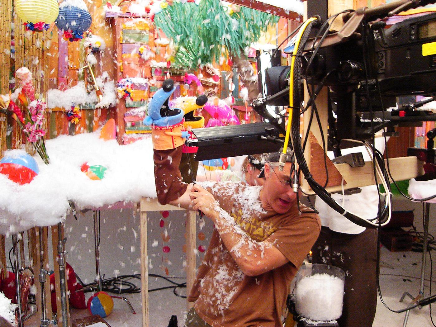 David Rudman braves a deluge of fake snow on the set of 'Jack's Big Music Show.' Photo: Courtesy Spiffy Pictures