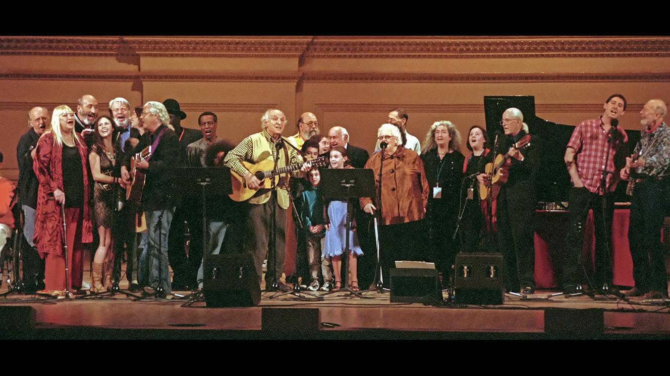 Pete Seeger & The Weavers, Peter, Paul & Mary, Arlo Guthrie and more on stage. Photo: Robert Corwin