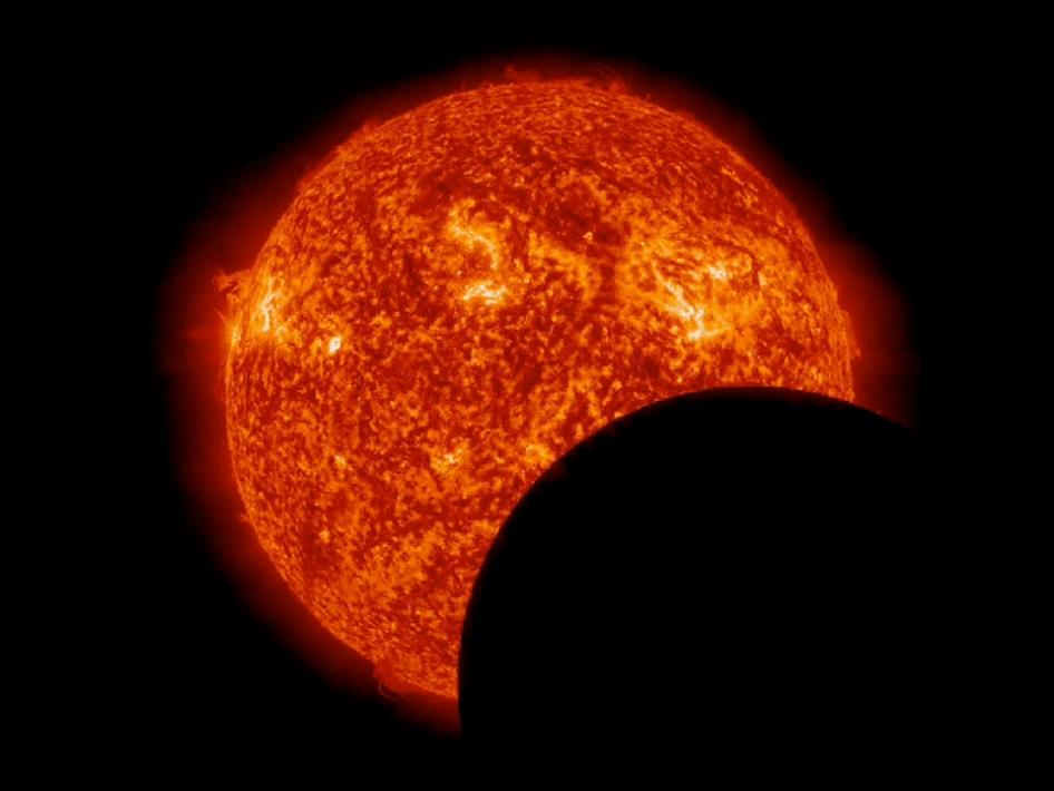 This image from NASA's Solar Dynamics Observatory shows the moon crossing in front of the sun. Photo: NASA/SDO