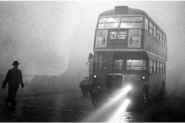 A double-decker bus during the Great Smog of London, in 1952