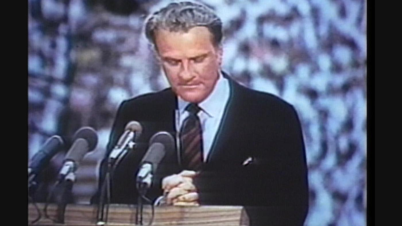 Billy Graham at one of his crusades in Knoxville, Tennessee in 1970, introducing Richard Nixon