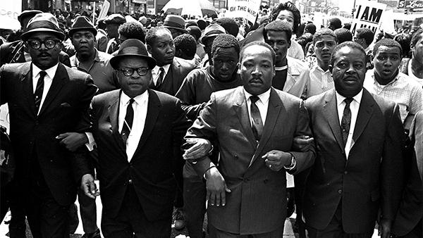 Rev. Ralph Abernathy, right, and Bishop Julian Smith, left, flank Dr. Martin Luther King, Jr., during a civil rights march in Memphis, Tenn., March 28, 1968, a few days before King was assassinated. Photo: AP Photo/Jack Thornell