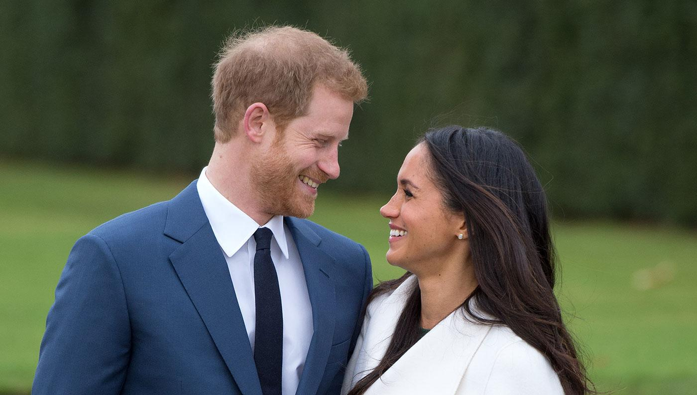 Prince Harry and Meghan Markle, wearing a white belted coat by Canadian brand Line The Label, attend a photocall in the Sunken Gardens at Kensington Palace following the announcement of their engagement on November 27, 2017 in London, England. Photo: Anwar Hussein/Getty Images
