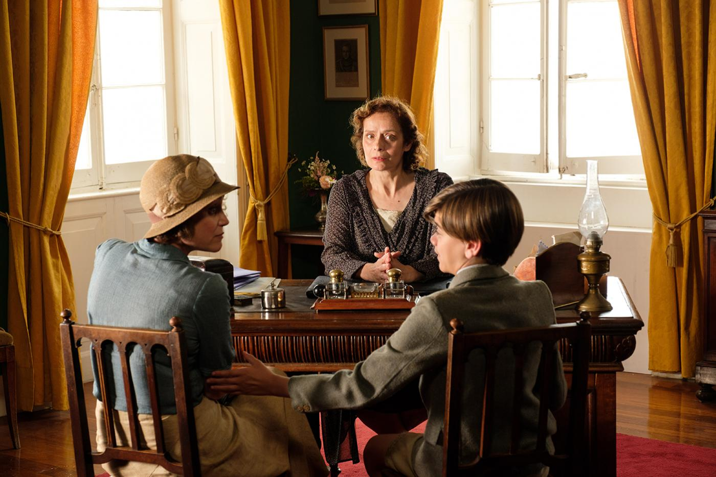 Louisa Durrell (KEELEY HAWES), Headmistress (NONI IOANNIDOU) & Gerald Durrell (MILO PARKER) in the Durrells in Corfu. Photo: Joss Barratt for Sid Gentle Films & MASTERPIECE