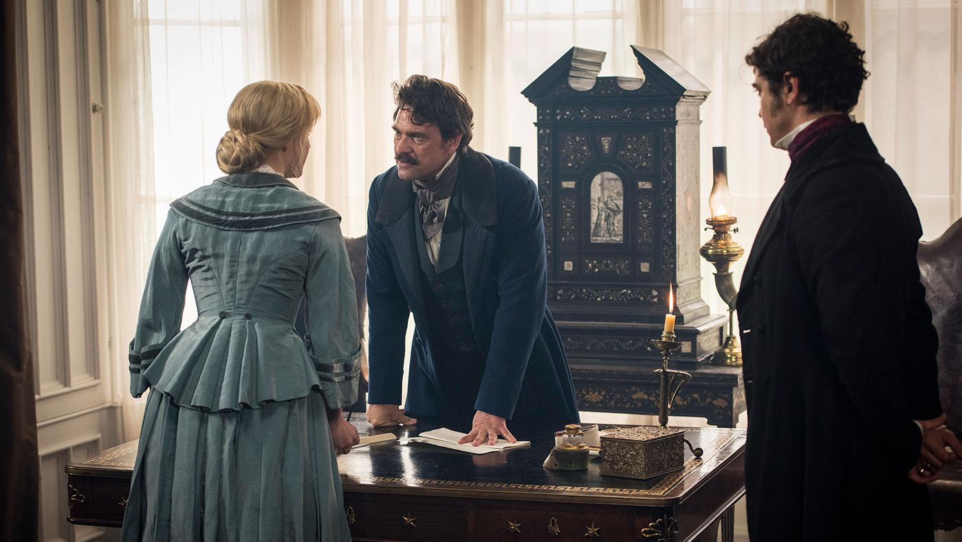 Olivia Vinall as Laura Fairlie, Dougray Scott as Sir Percival Glyde, and Riccardo Scamarcio as Count Fosco in The Woman in White. Photo: The Woman in White Productions Ltd. / Steffan Hill / Origin Pictures