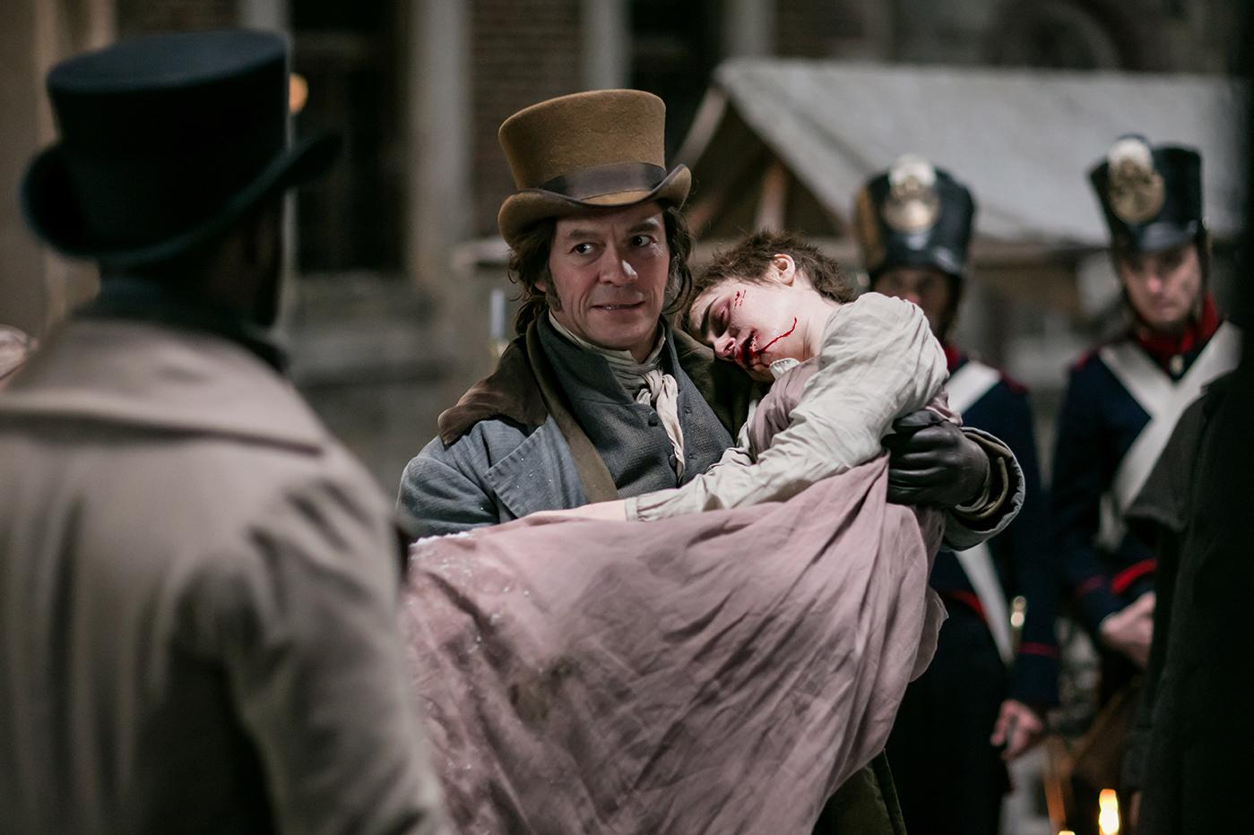 Javert (David Oyelowo), Jean Valjean (Dominic West), Fantine (Lily Collins) in Les Miserables. Photo: Robert Viglasky / Lookout Point