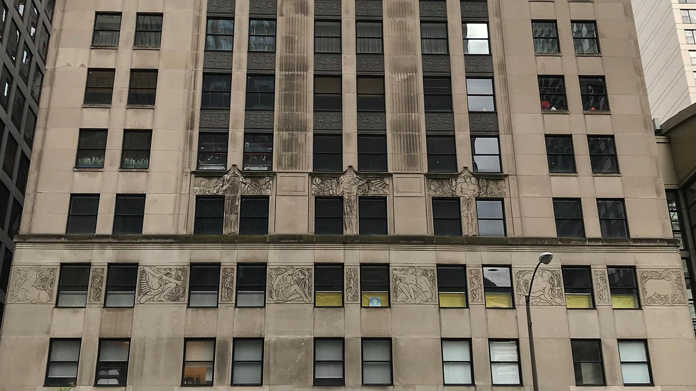 The facade of the McGraw-Hill Building features sculptural panels with Greek deities and the Zodiac, by the artists Gwen and Eugene Lux