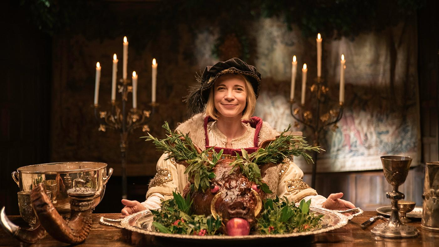 Lucy Worsley in Henry VIII costume with boar's head for Lucy Worsley's 12 Days of Tudor Christmas. Photo: Burning Bright Productions