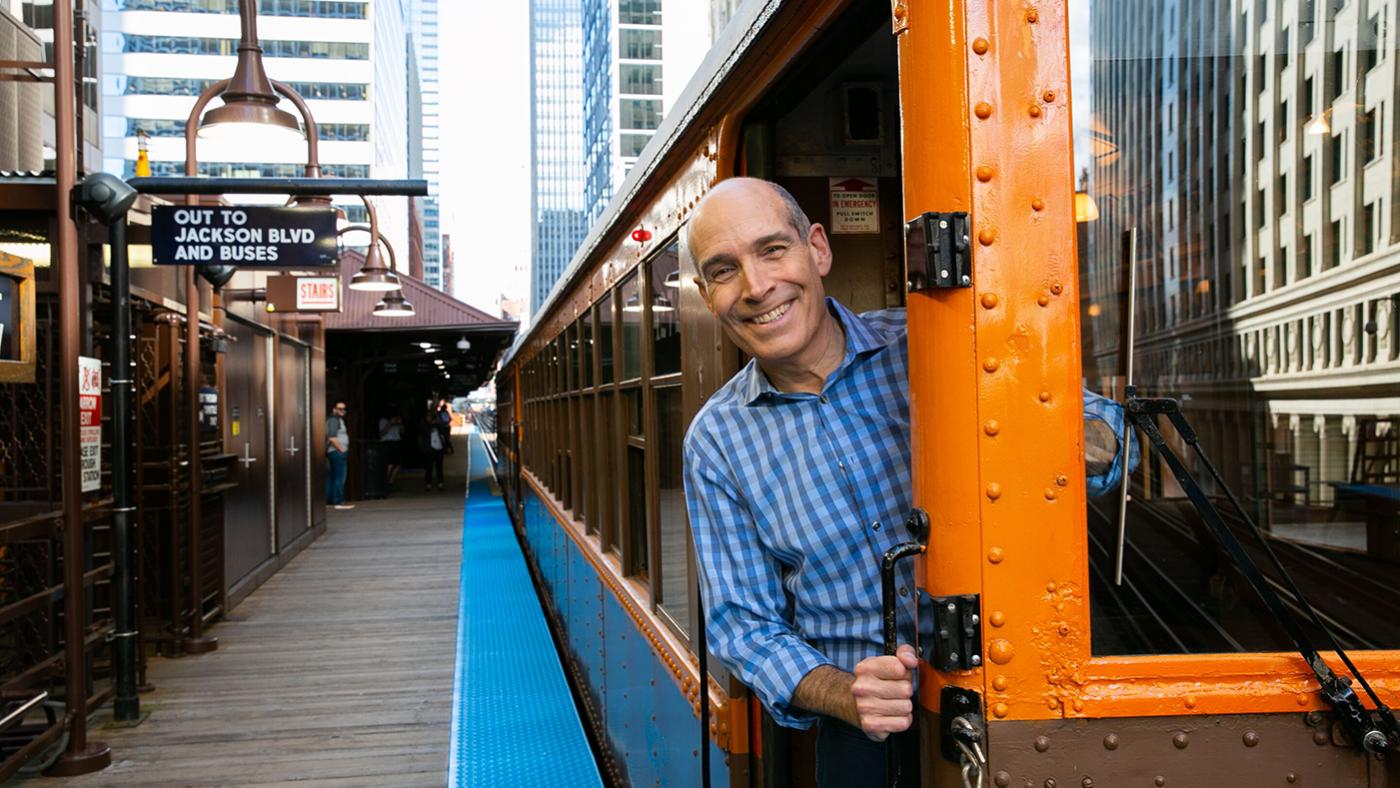 Geoffrey Baer riding a CTA heritage train in Chicago by 'L.' Photo: Kristan Lieb