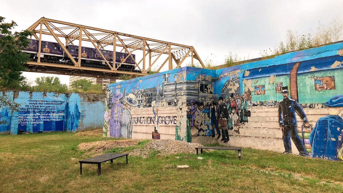 The Green Line passes over a mural noting the previous name of Englewood: Junction Grove. Photo: Brendan Brown