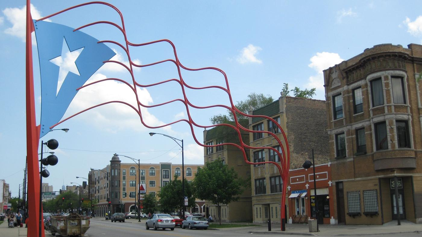 The steel Puerto Rican flag over Division Street in Humboldt Park. Photo: Richie Diesterheft/Wikimedia Commons