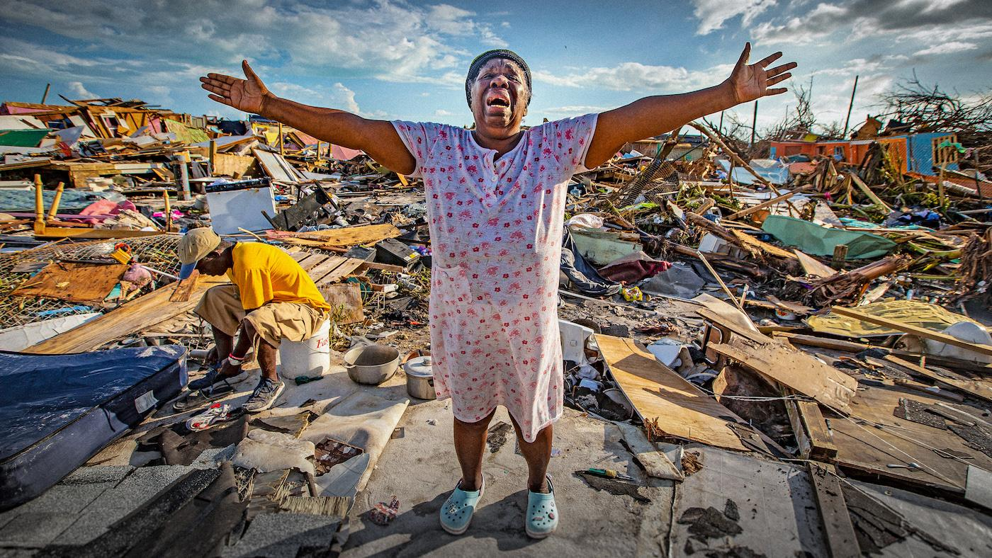 "Aliana Alexis of Haiti stands on the concrete slab of what is left of her home after destruction from Hurricane Dorian in an area called ""The Mud"" at Marsh Harbour in Great Abaco Island, Bahamas on Thursday, September 5, 2019. Photo: Al Diaz/Miami Herald/Tribune News Service"