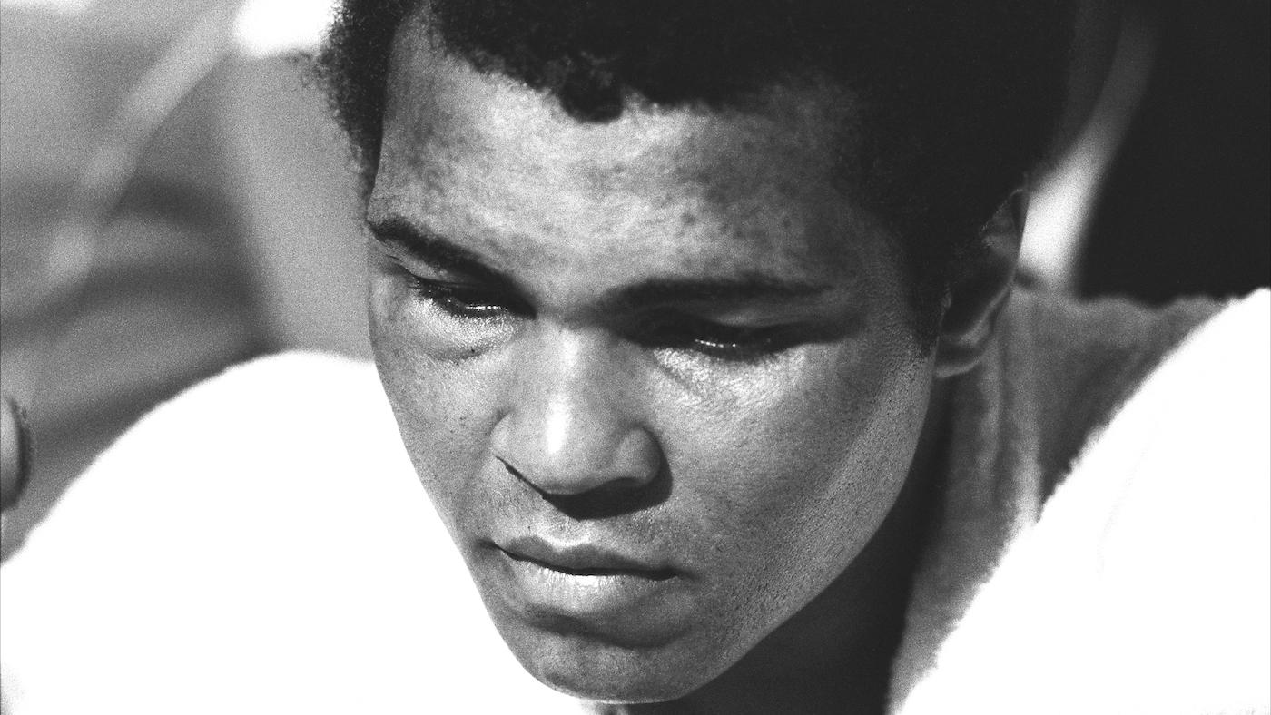 After a shocking loss of the Heavyweight title to Leon Spinks, with swollen eyes Muhammad Ali faces the press conference after the fight. Las Vegas, NV. February 15, 1978. Photo: Courtesy Michael Gaffney