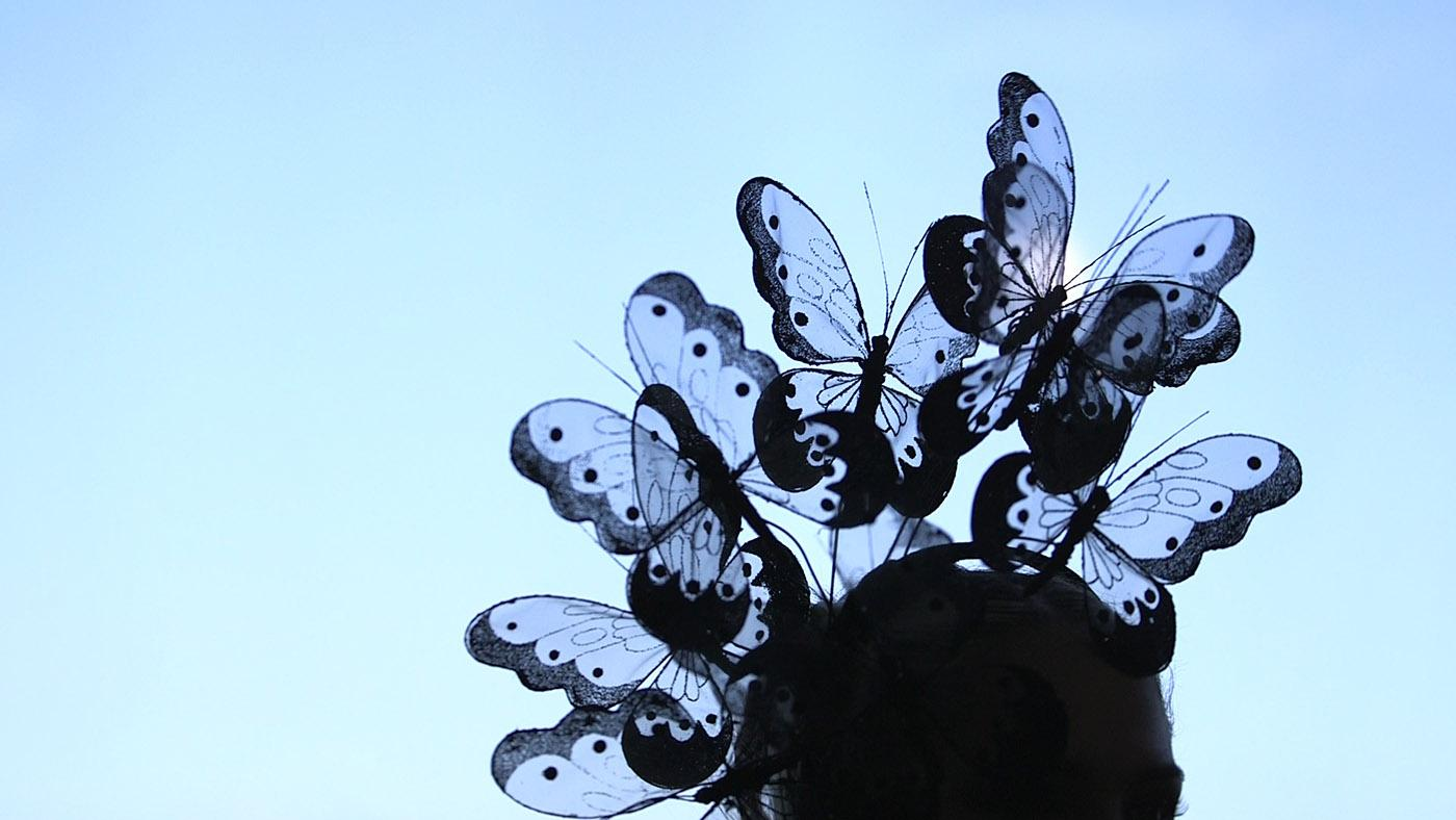 A butterfly hat by Arturo Rios on Articulate with Jim Cotter