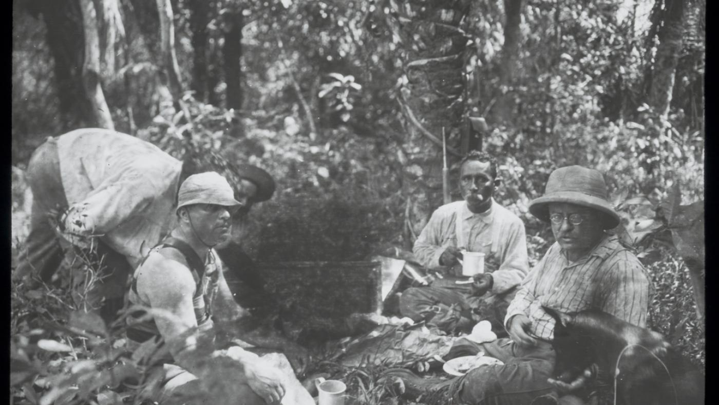 Theodore Roosevelt, Candido Rondon and camaradas sitting in camp, 1914. Photo: Courtesy of the Library of Congress