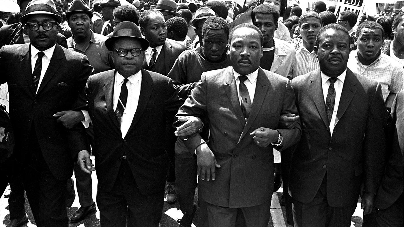 The Rev. Ralph Abernathy, right, and Bishop Julian Smith, left, flank Dr. Martin Luther King, Jr., during a civil rights march in Memphis, Tenn., March 28, 1968. AP Photo/Jack Thornell