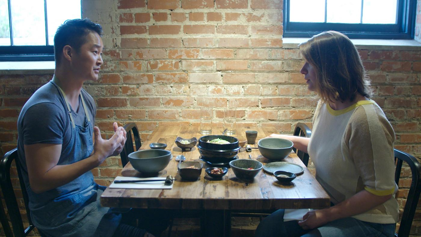 Chef Mike Lee eats Korean samgyetang and banchan with Chef Vivian Howard at his restaurant M Sushi in Durham, in 'South by Somewhere.' Photo: Blaire Johnson/Markay Media