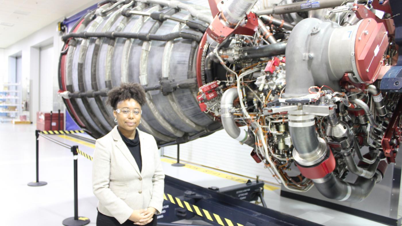 Advocate Tiera Fletcher by a rocket engine at NASA. Photo: Bigger Bang Communications