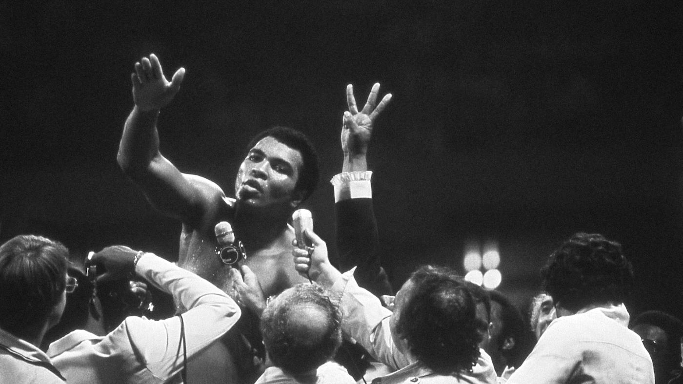 Muhammad Ali talks with the press after winning back the Heavyweight Championship for an unprecedented third time by beating Leon Spinks at the Super Dome in New Orleans, LA. September 15, 1978. Photo: Courtesy of Michael Gaffney