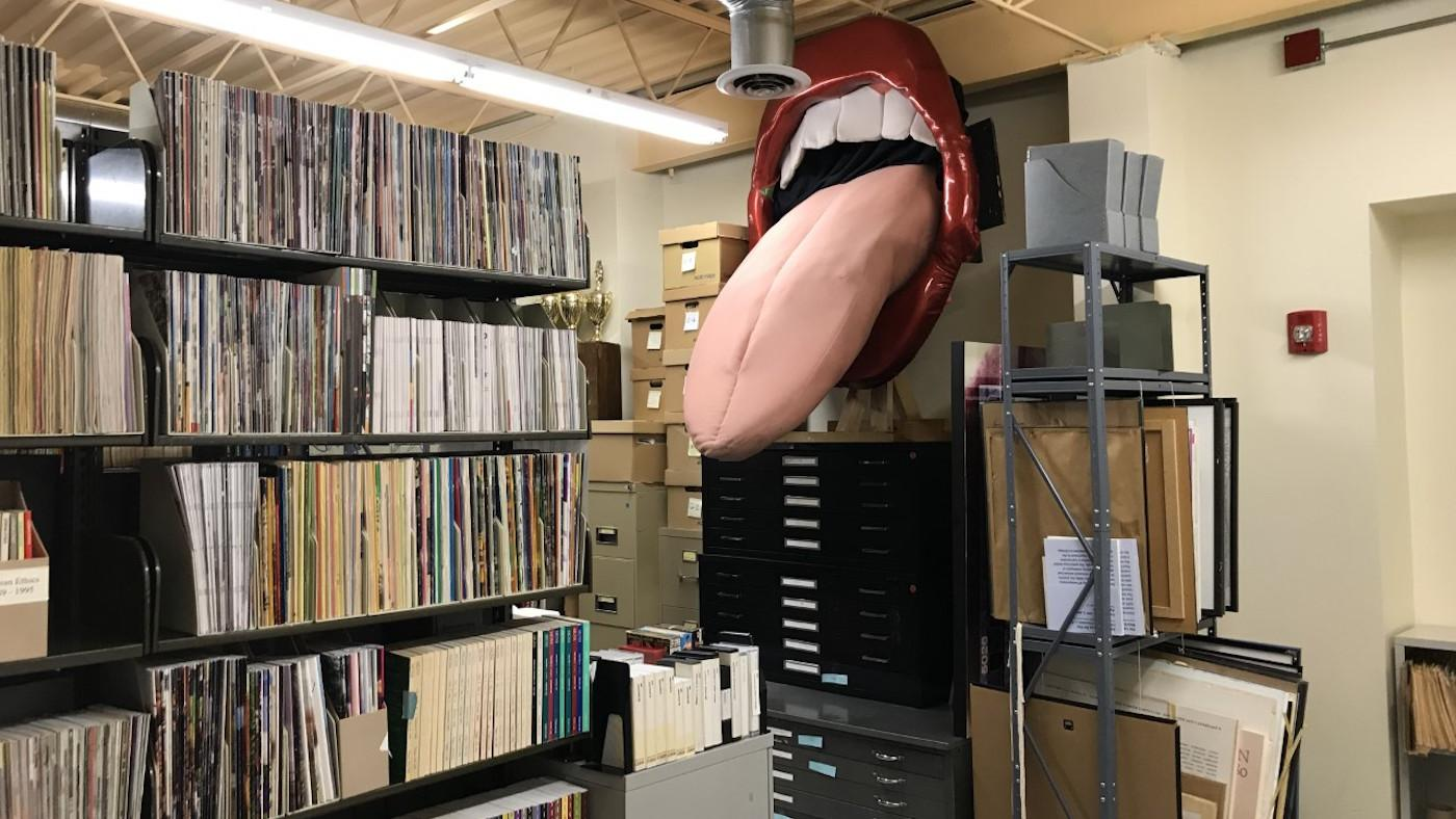 A mouth with its tongue sticking out that used to hang in Carol's Speakeasy and now resides in the Gerber/Hart Library and Archives