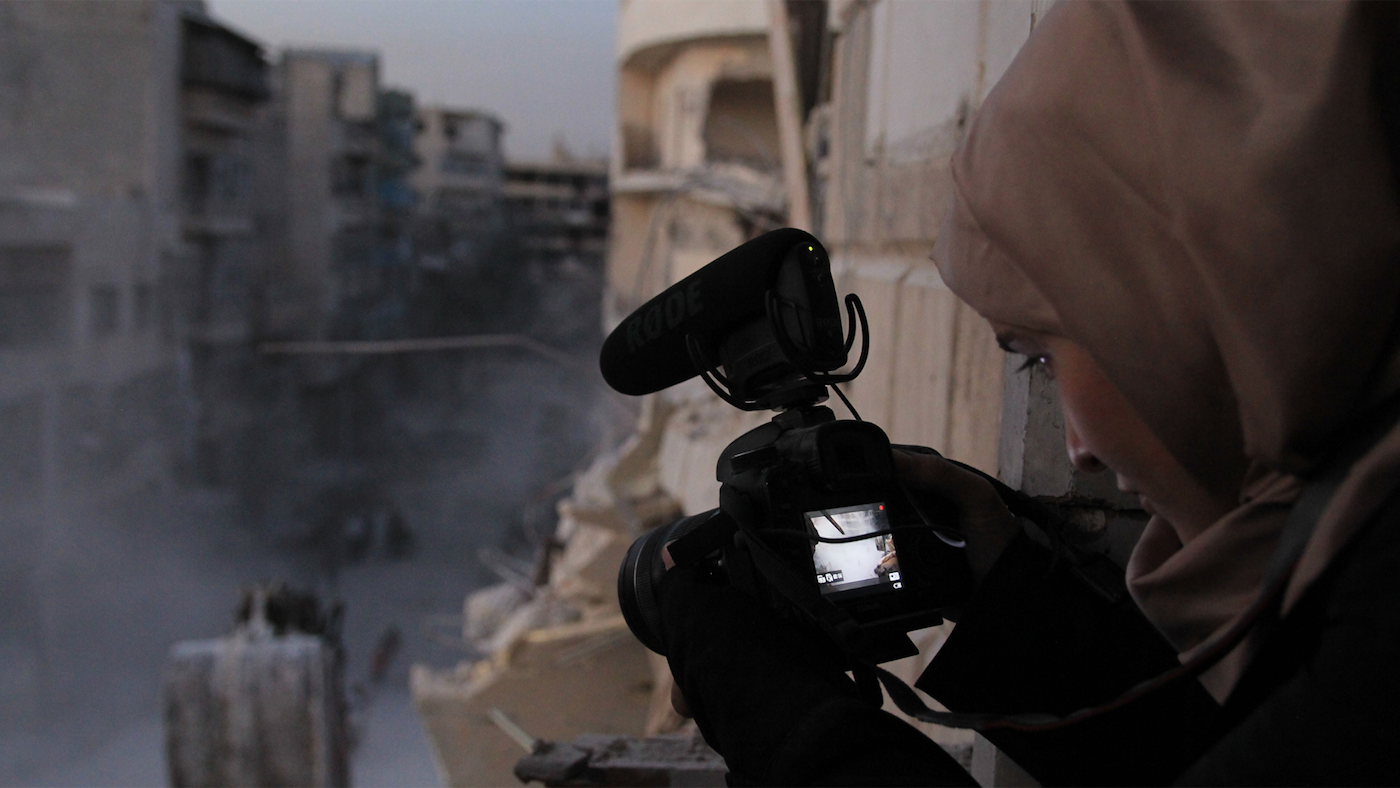 Waad al-Kateab filming the ruins of a building destroyed by bombing in besieged east Aleppo in October 2016. Photo: Waad al-Kateab/FRONTLINE