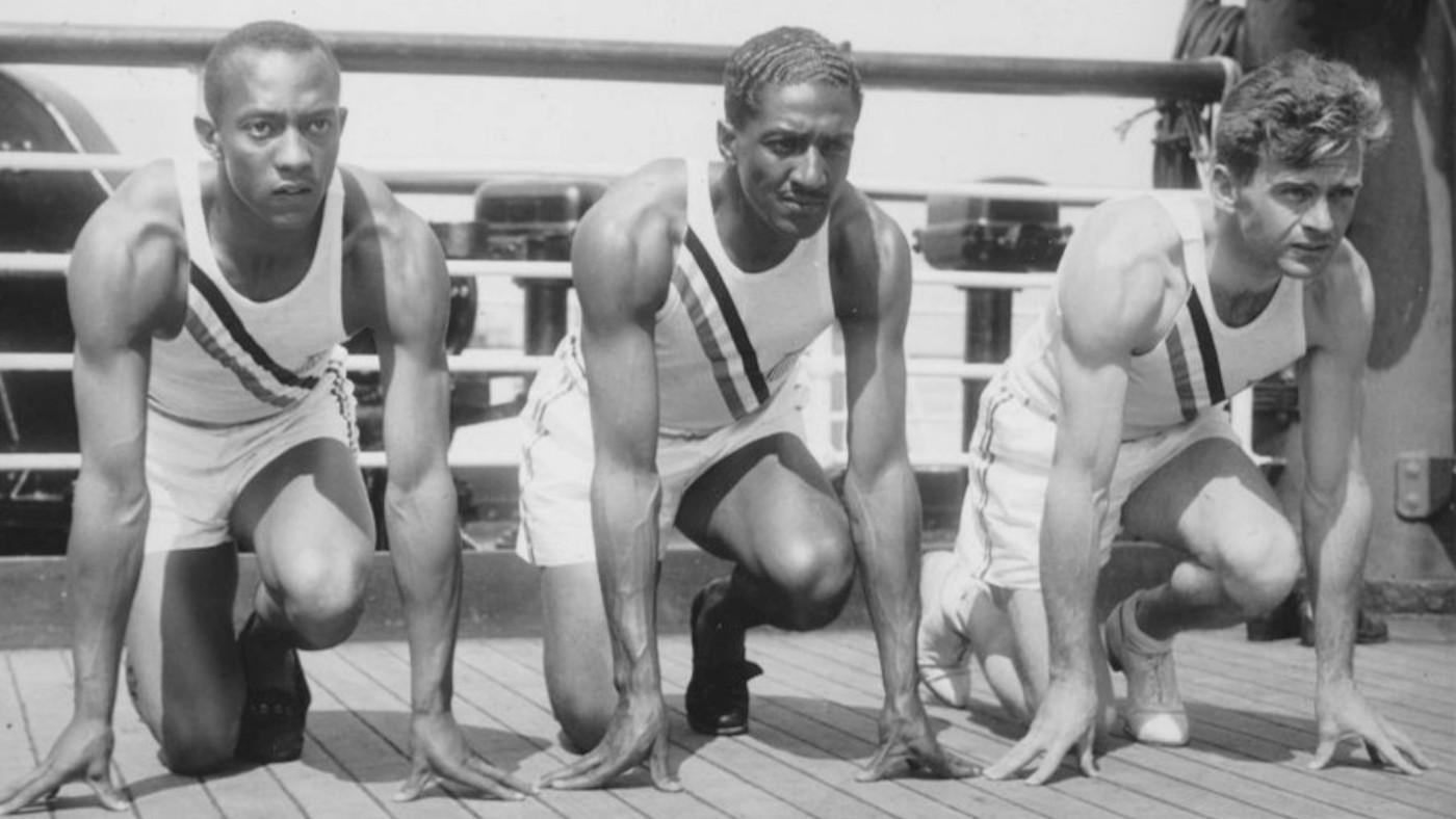 Photo of US Olympic team sprinters (from left) Jesse Owens, Ralph Metcalfe and Frank Wykoff on the deck of the S.S. Manhattan before they sailed for Germany to compete in the 1936 Olympics. Photo: Public domain/Wikimedia Commons