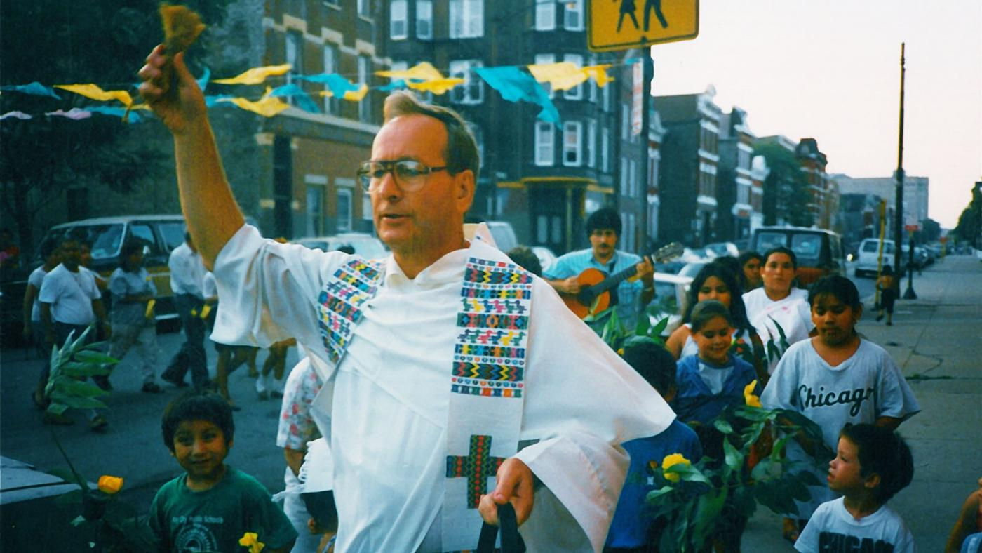 Charles Dahm blesses homes in the Pilsen neighborhood