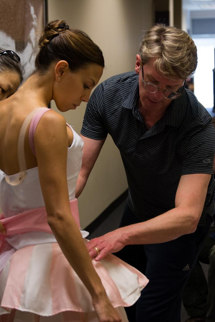 Artistic Director Ashley Wheater with Joffrey Ballet dancer Anais Bueno in costume fittings for the Nutcracker. Photo: Chloe Hamilton