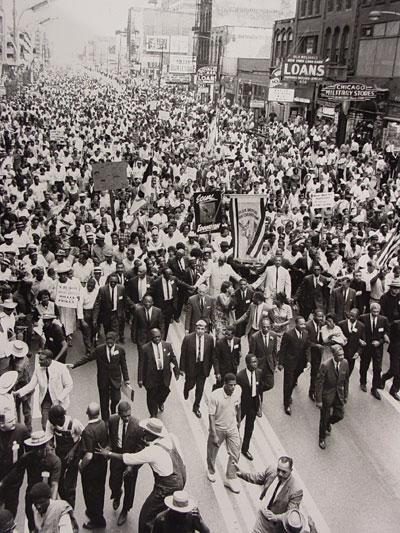 Martin Luther King, Jr. (center, bottom third of image) marches along State Street in 1966 as part of the Chicago Freedom Movement. Photo: Chicago Defender Archives