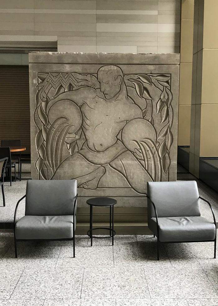 A sculptural panel of Aquarius by Eugene and Gwen Lux depicting Aries that originally decorated the facade of the McGraw-Hill Building and is now located in the Shops at North Bridge