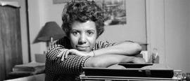 Lorraine Hansberry seated in front of a typewriter