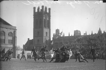 Football players grappling on University of Chicago's Stagg Field in 1929