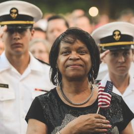An audience member stands for the national anthem at a previous broadcast of the National Memorial Day Concert. Photo: Capitol Concerts