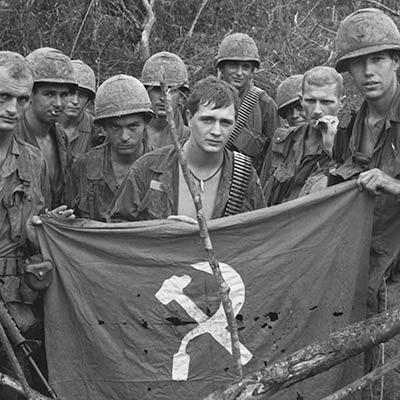 American soldiers display captured enemy flag. January 19, 1967. Photo: Bettmann/Getty Images