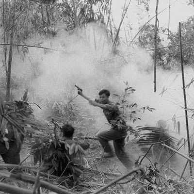 North Vietnamese Army officer leads an attack on South Vietnamese forces. Laos 1971. Photo: Doug Niven