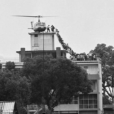 South Vietnamese civilians scramble to board a helicopter during the evacuation of Saigon. April 29, 1975. Photo: Hubert (Hugh) Van Es/Getty Images