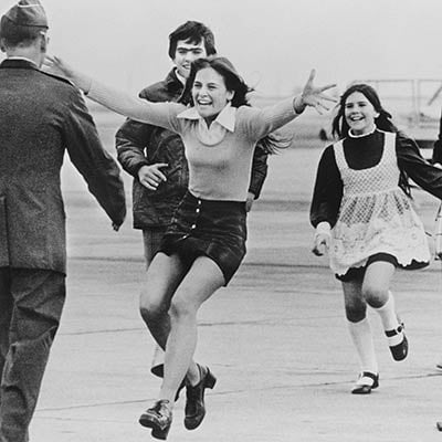 Released POW, Lt. Col. Robert L. Stirm, is greeted by his family. Travis Air Force Base, March 17, 1973. Photo: AP Photo/Sal Veder