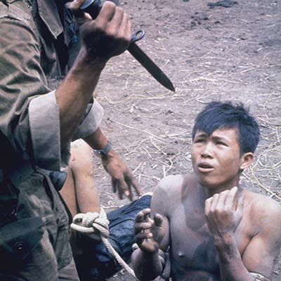 South Vietnamese soldier threatens a Viet Cong suspect. 1962. Photo: Larry Burrows/Getty Images