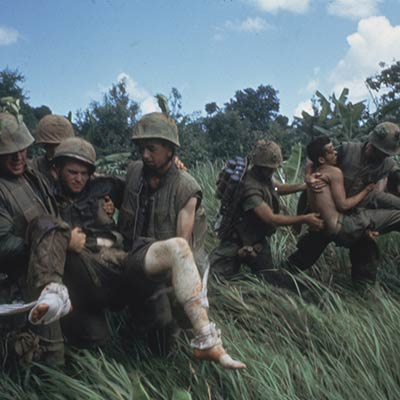 Marines carrying their wounded during firefight near the DMZ. 1966. Photo: Larry Burrows/Getty Images