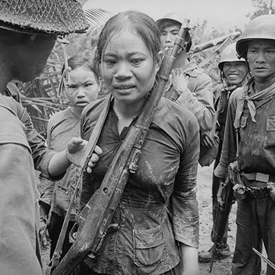 Suspected Viet Cong soldier carrying a Russian-made rifle, awaiting interrogation. August 25, 1965. Photo: Associated Press