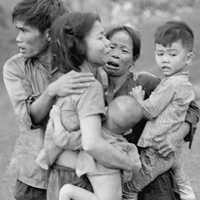 Civilians huddle together after an attack by South Vietnamese forces. Dong Xoai, June 1965. Photo: AP/Horst Faas