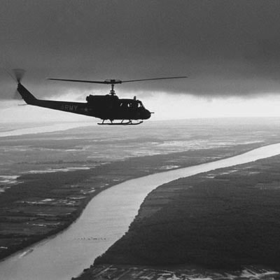 South Vietnamese troops fly over the Mekong Delta. 1963. Photo: Rene Burri/Magnum Photos