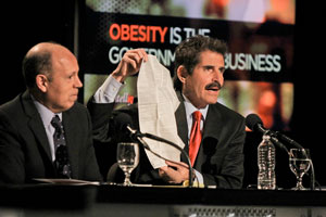 Paul Campos and John Stossel