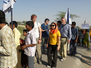Northwestern University students marching with villagers
